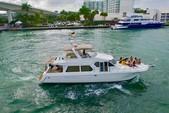 60 ft. Navigator Rival Flybridge Boat Rental Miami Image 1