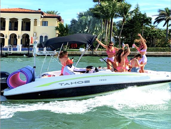 Rent a Tahoe 1950 deck boat in Miami Beach, FL near me